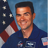 Photo of NASA astronaut Duane Carey with American flag