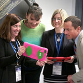 Photo of teachers looking at iPad