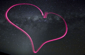 Image of the outline of a heart against space background