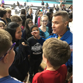 Photo of astronaut Digger Carey with students